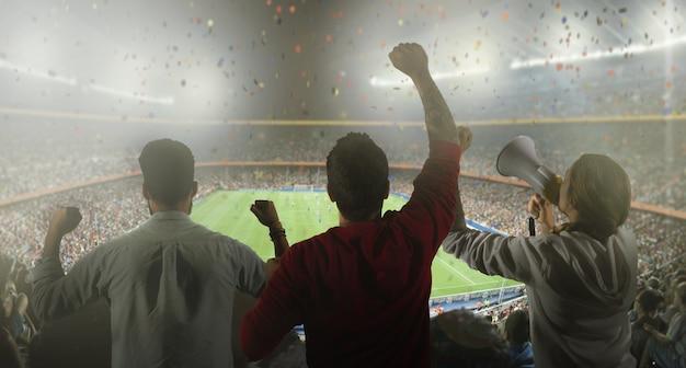 スタジアムのサッカーファンのバックビュー