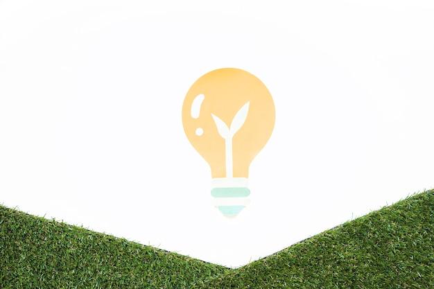 Лампочка с лепестком и травой