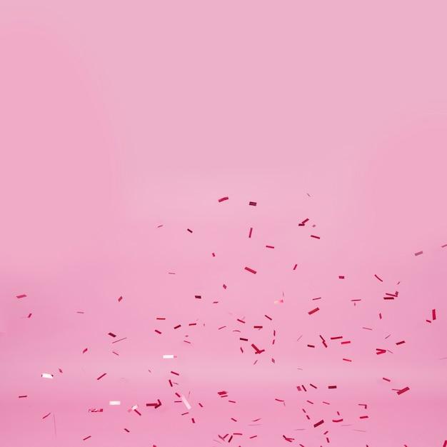 ピンクの背景に暗い紙吹雪