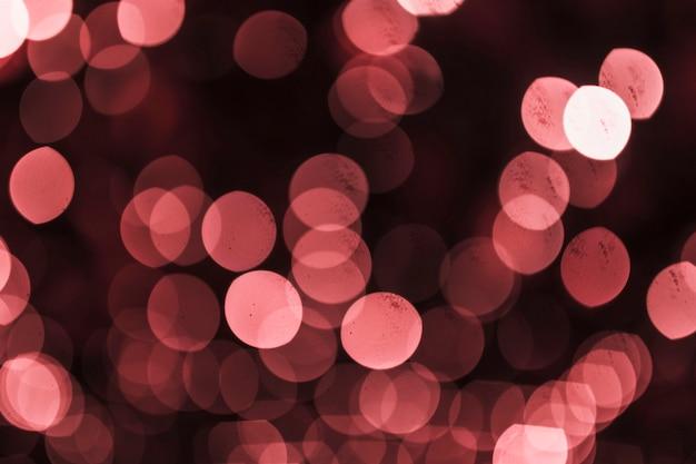 赤いお祝いのデフォーカスされた光の背景