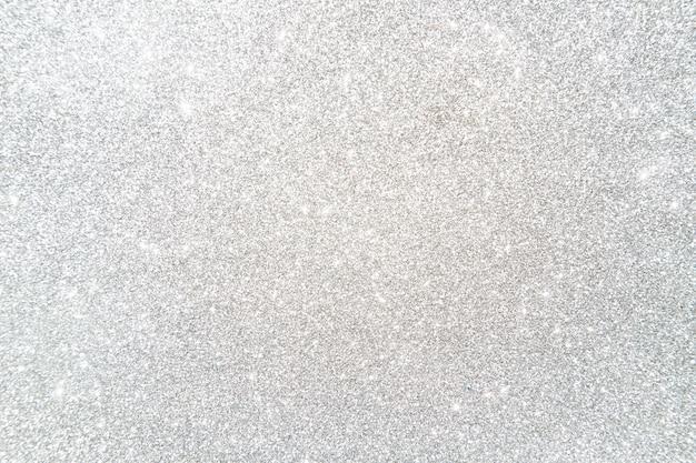 光沢のある銀色のキラキラの背景の高い角度のビュー