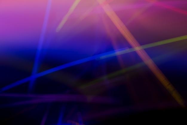 カラフルなネオンレーザー光の抽象的な背景