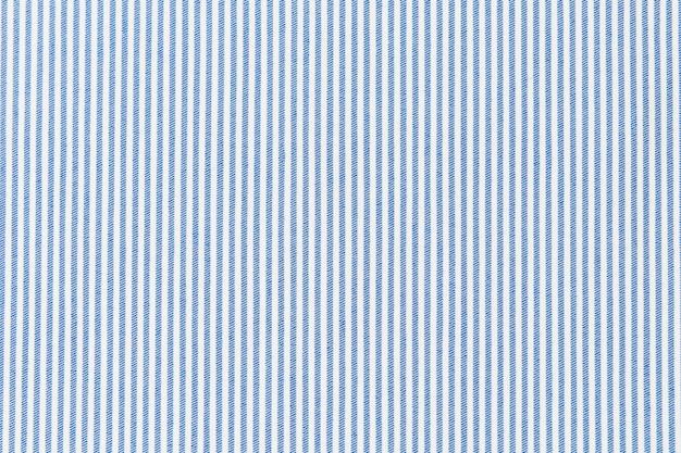 白い布のテクスチャの背景に青いストライプの線