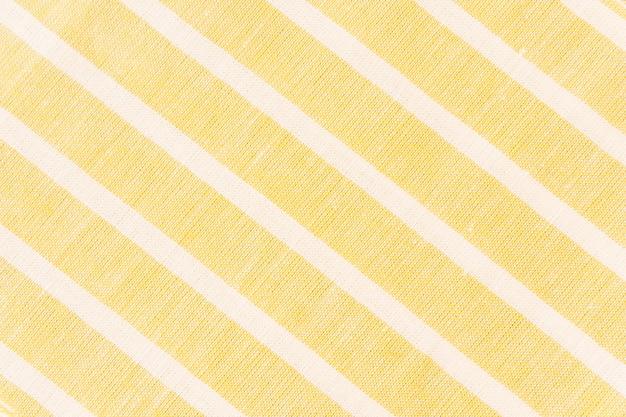 黄色のファブリック上の白い斜線
