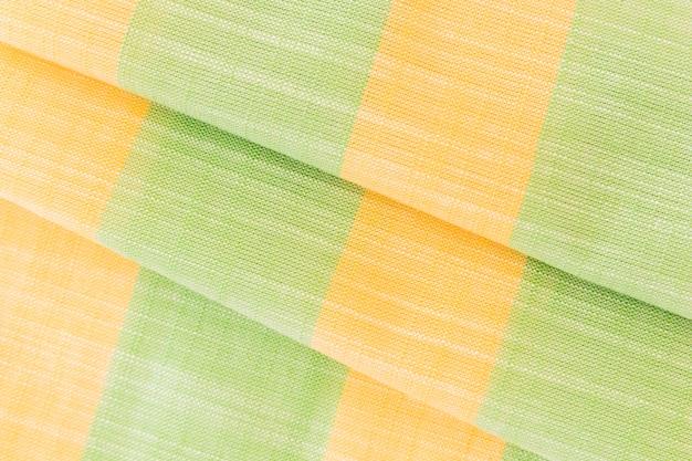デザインのための緑と黄色の天然の生地のリネンのテクスチャ