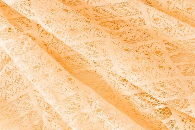 花のデザインの布のテクスチャのキャンバスの背景