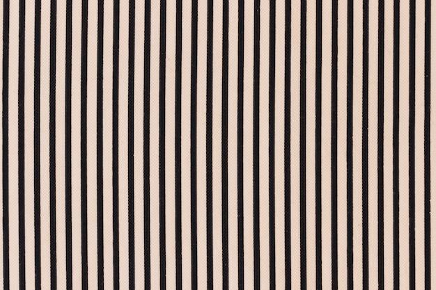 クリームの背景に黒いストライプのパターン