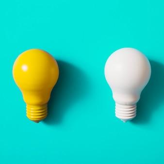 ターコイズブルーの背景に黄色と白の電球
