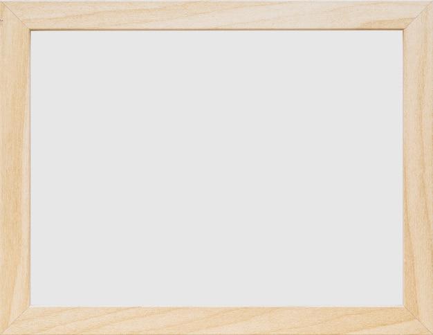 白い空の木製のフレームのクローズアップ