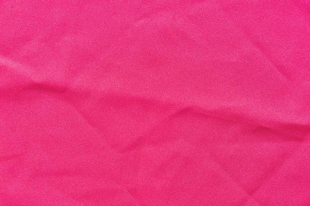 ピンクの布の背景のフルフレーム