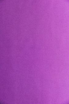 紫色の生地のテクスチャの背景