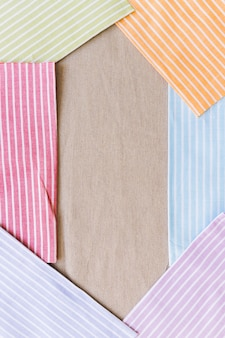 様々なカラフルな縞模様の織物テクスチャの背景に袋の布のテクスチャの背景