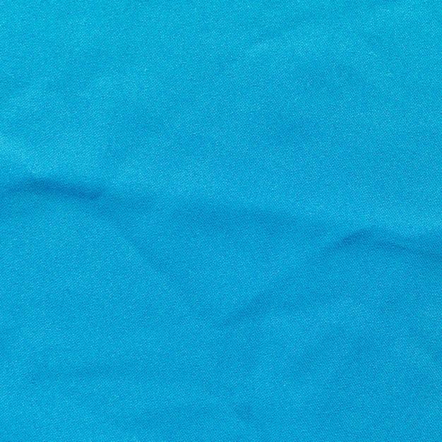 Крупным планом синий текстурированный фон ткани
