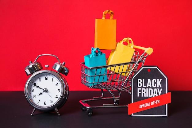 ショッピングトロリー、小さなパケット、目覚まし時計、サイン