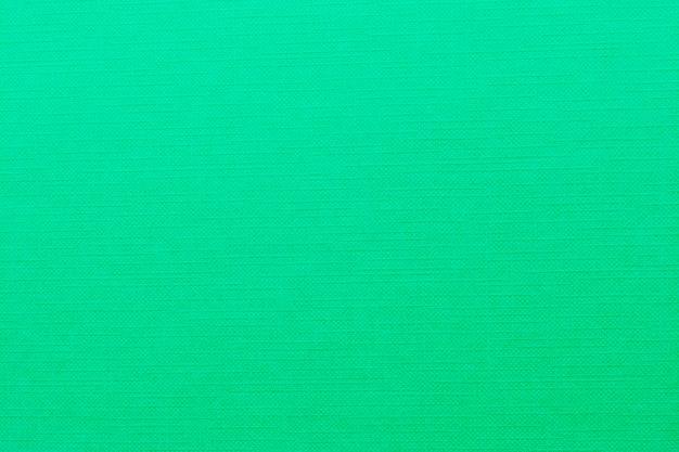 Зеленый фон текстуры ткани