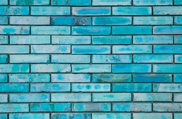 青塗りのレンガの壁のテクスチャ