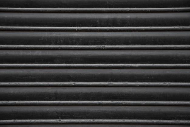 黒い金属の壁の背景
