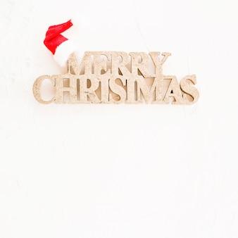パーティーの帽子と装飾的なメリークリスマスの碑文
