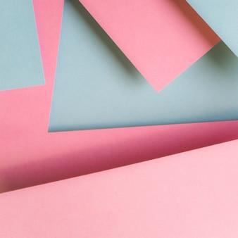ピンクとグレーの紙のデザインの抽象的な背景
