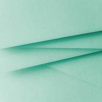 パステルカラーの紙の幾何学的なフラットレイアウトの背景
