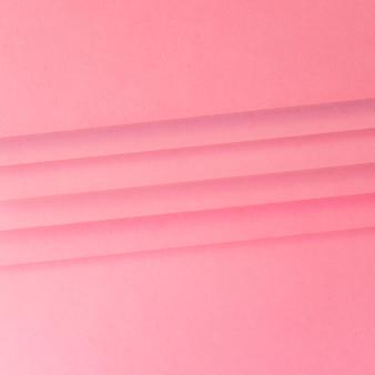 ピンクの紙のテクスチャ背景の上の線のクローズアップ