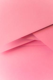 ピンクのパステルカラーの紙のバナーの背景