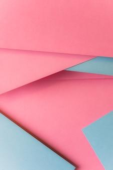 ピンクとグレーのカード紙の抽象的な背景の平面図