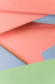 おしゃれなパステルカラーの紙の背景のクローズアップ