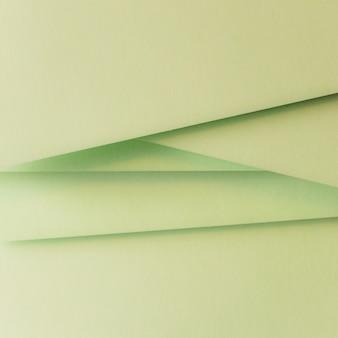 グリーンカード紙の抽象的な背景の積み上げ