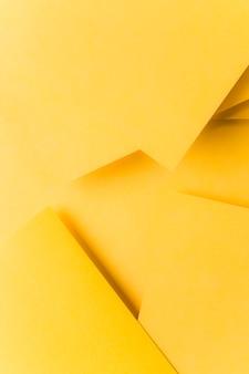 抽象的な黄色い折り紙の背景