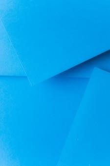 抽象的な紙の背景を青ポップアップ