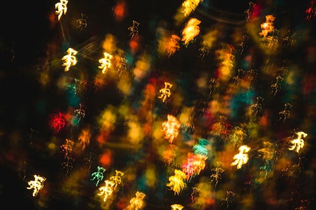 抽象的な活気あるカラフルなクリスマスライト