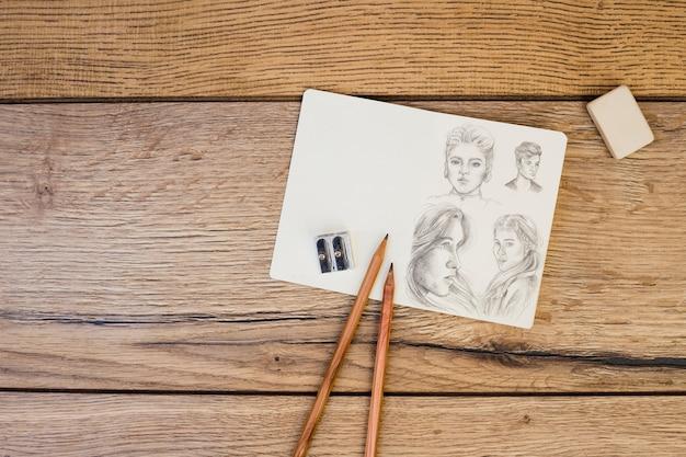 ノート、鉛筆を持つアーティストコンセプト