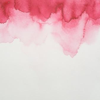 白紙の塗料の赤ブロット
