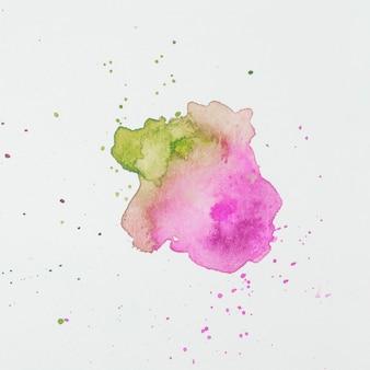 白い紙のペイントのピンクとグリーンのブロット