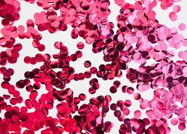 ピンクの紙吹雪と抽象的な背景