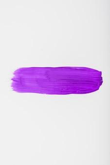 あなた自身のテキストのためのスペースを持つ紫色の水彩ブラシストローク