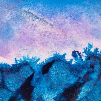 青い水彩絵の具の抽象的な背景