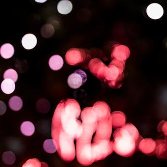 Праздник светящийся расфокусированным фоном с мигающими огнями