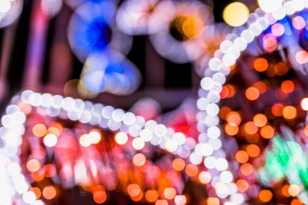 抽象的なきらびやかな輝き電球ライトの背景