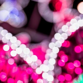 きらびやかな輝き電球ライトの背景