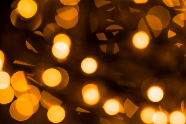 ボケ味の光とお祝いのエレガントな抽象的な背景