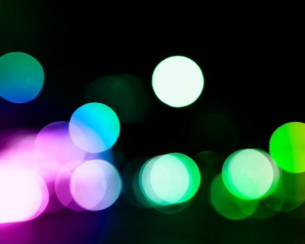 ボケ味とカラフルな輝くお祭りの背景デフォーカスライト