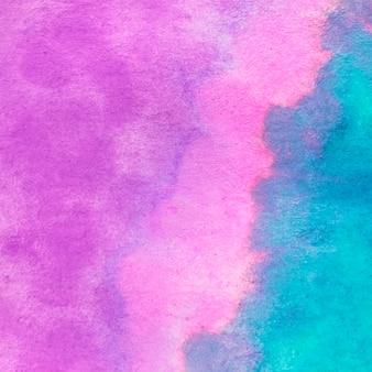 水彩のピンクとターコイズブルーのテクスチャ背景のフルフレーム