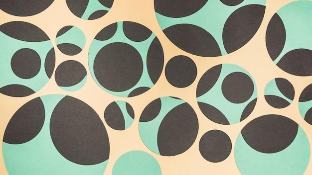 黄色のパノラマビュー。黒と緑の幾何学的な紙の壁紙