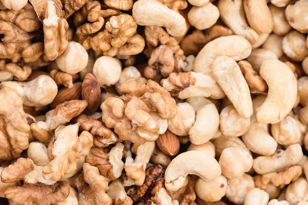 Полный кадр вид грецких орехов; фундук и кешью