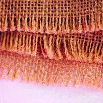 ピンク色の黄麻布材料の繊維の概念