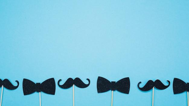 蝶ネクタイと杖の口ひげ