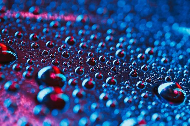透明な水滴がテクスチャ背景