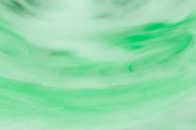 明るい緑色のストロークのクローズアップのテクスチャ背景